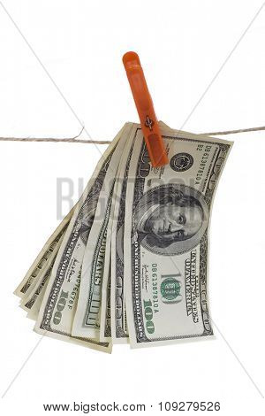 Hudred dollar bills hanging on rope isolated over white background. Money laundering concept