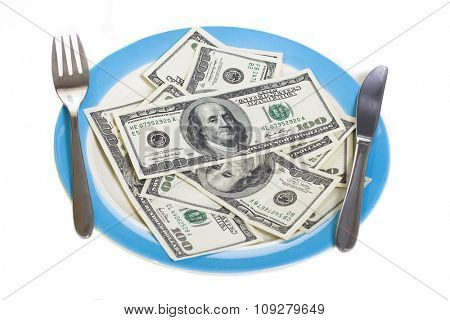 Few hundred dollars on food plate with fork and knife isolated on white. Business money and finance concept