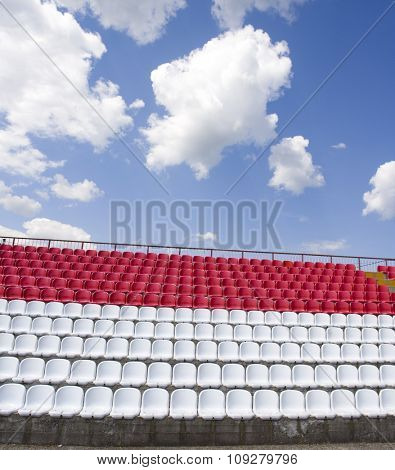 Red and white outdoor stadium seats