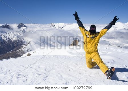 Skier takes a break on top of the mountain. French alps in in background