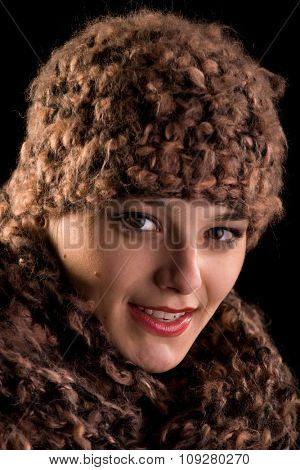 Pretty young woman with winter hat and happiness in eyes