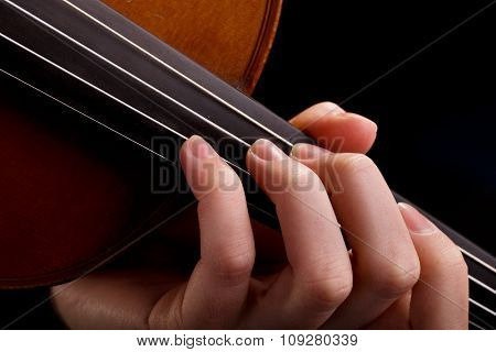 Musician playing violin. Closeup on fingers. Classical music concept