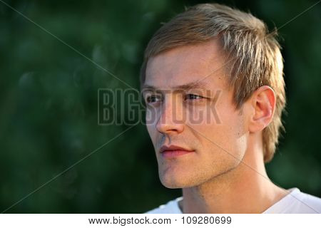 Portrait of handsome man outdoor looking on side