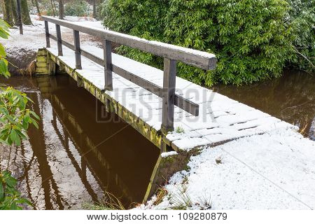Wooden Bridge Covered With Snow In Winter