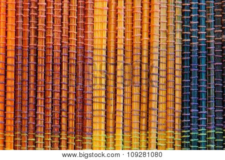 Table cloth of bamboo sticks detail. Colorful background
