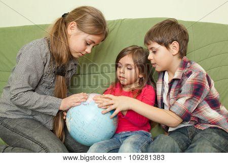 Kids Looking At Globe