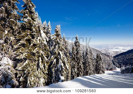 Steep ski mountain  slope in a winter holiday resort