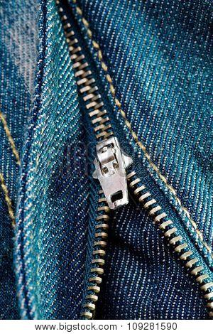 Zipper on blue jeans, closeup detail