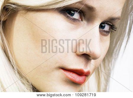 Young beautiful caucasian blond woman, side view portrait