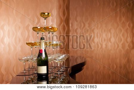 Wine glasses full of wine one on another forming  a  pyramid