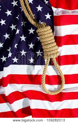 Hangman knot on American flag. Death penalty concept