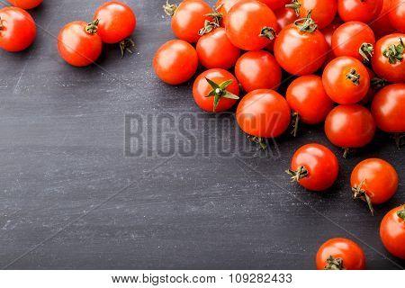 Fresh Cherry Tomatoes On Black Board