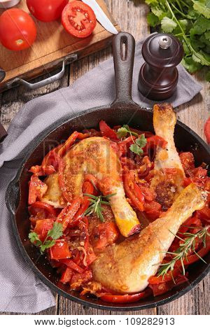 chicken leg cooked with pepper and tomato