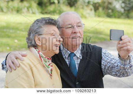 elderly couple doing selfie