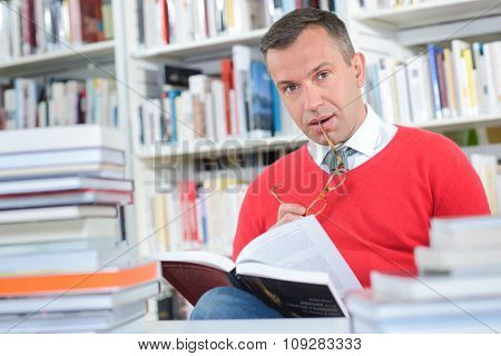 Portrait of middle aged man in library