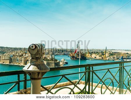 observation deck with panoramic view of Valletta, Malta and telescope in the foreground