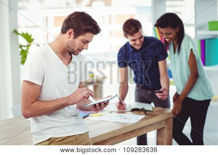 Smiling creative team working together in casual office
