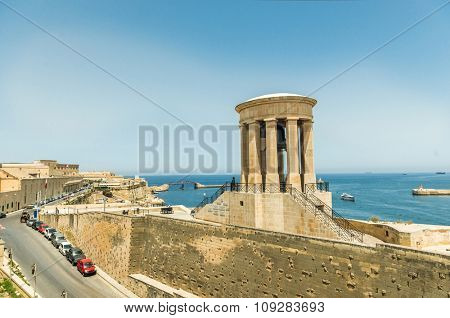 Siege Bell Memorial in Valletta on the sea background in Malta