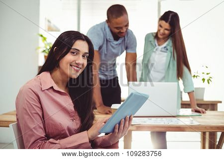 Young creative team working together in casual office