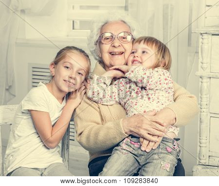 greatgrandmother with two greatgranddaughters portrait