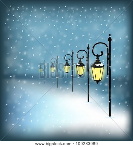 Lanterns stand in snowfall on blue