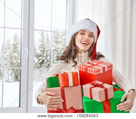 Beautiful young woman with gift boxes