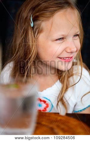 Casual portrait of adorable little girl