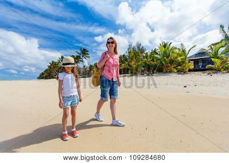 Mother and daughter at tropical beach on exotic island