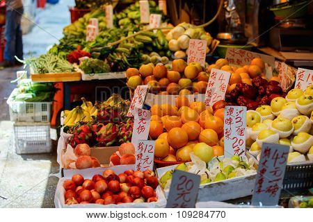 Assortment of fresh fruits on outdoor market stall