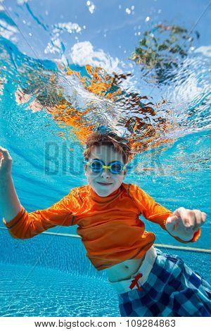 Cute boy underwater in swimming pool