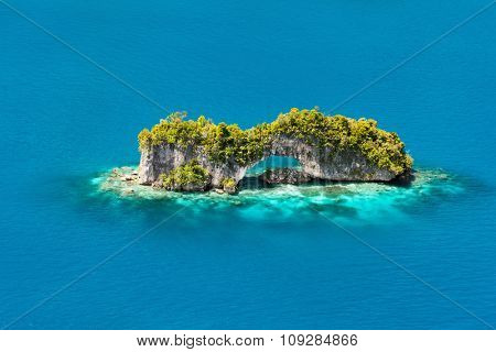 Beautiful view of The Arch nature landmark in Palau from above