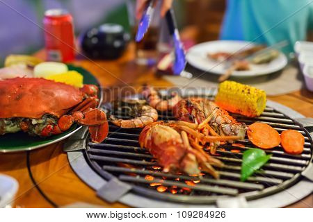 Close up of fresh seafood and vegetable preparing on grill