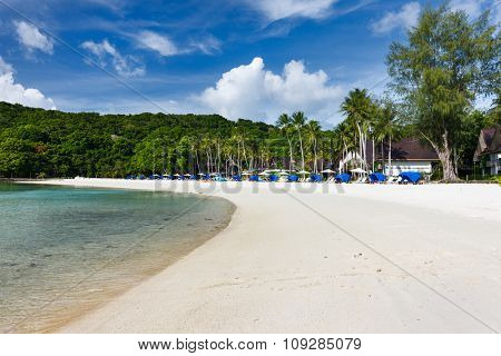 Beautiful tropical beach with white sand, turquoise ocean water and blue sky at exotic island