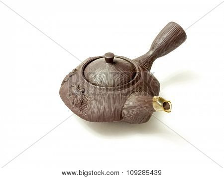GOMEL, BELARUS - NOVEMBER 15, 2015: The Japanese porcelain teapot. Porcelain (also known as china or fine china) is a ceramic material made by heating materials.