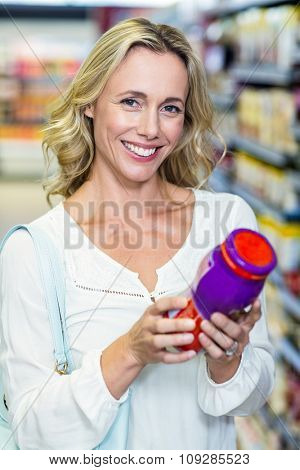 Woman reading nutritional values at supermarket