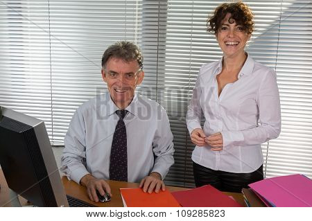 Senior Business Man With Brunette Female Colleague Discuss Something