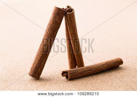 Cinnamon Sticks On Corkwood Background.