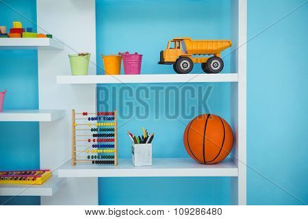 Close up of some shelves with toys on them
