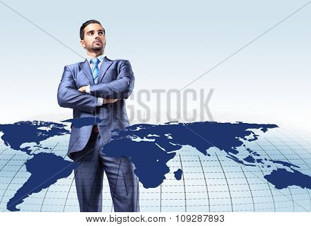 Young attractive businessman with world map