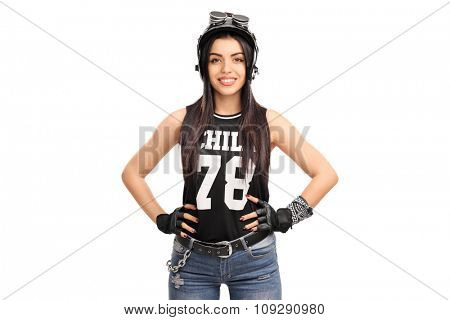 Studio shot of a young female biker with black helmet and goggles isolated on white background