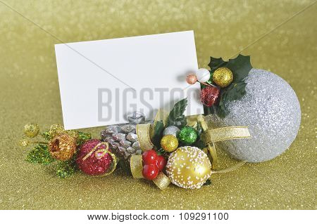 Blank Christmas Card With Christmas Ornament On Gold Background