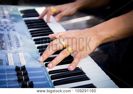 Pianist Hand With Ring On The Electric Piano