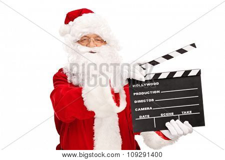 Studio shot of Santa Claus holding a movie clapperboard and looking at the camera isolated on white background