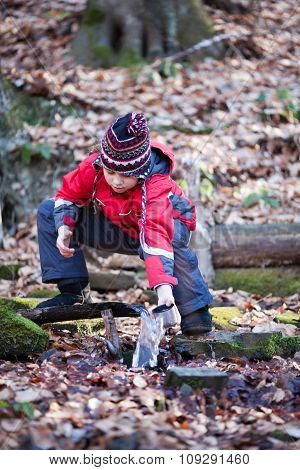 Child Taking Water From Spring
