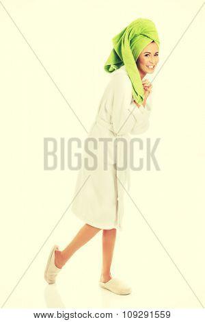 Full length woman wearing a bathrobe.