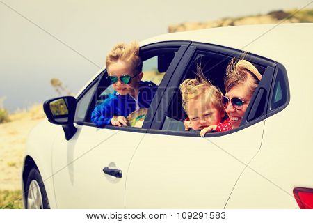 mother with son and daughter travel by car