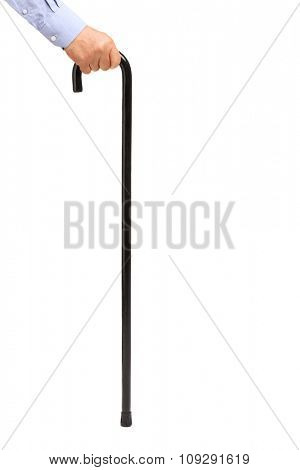 Close-up vertical shot of a male hand holding a black cane isolated on white background