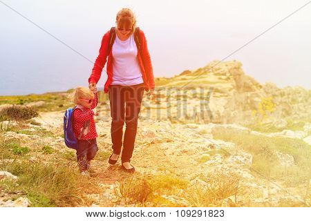 mother and little daughter travel in mountains