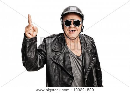 Cheerful senior biker in black leather jacket pointing up with his finger isolated on white background