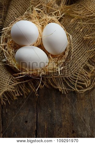 Eggs At Hay Nest In Chicken Farm